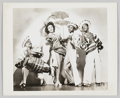 Photograph of a performer, Toada, and three men dressed in theatrical costumes