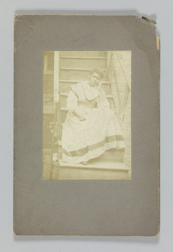 Image for Albumen print of an unidentified woman sitting on stairs