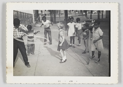 Photographic print of children playing on the sidewalk