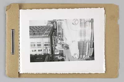 Packet of four black and white photographs and one negative