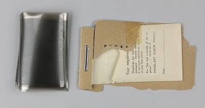 Set of five photographic negatives in a paper envelope