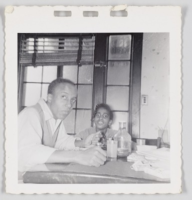 Photographic print of Orville and Paula Williams sitting at a table