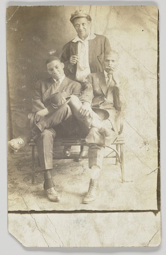 Image for Photographic postcard of three unidentified men