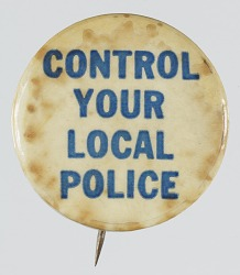 """Pinback button with the slogan """"Control Your Local Police"""""""