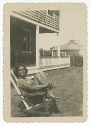 Digital image of a woman outside the Taylor family home on Martha's Vineyard