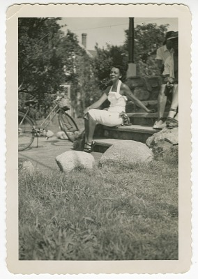 Digital image of a young woman with a bicycle on Martha's Vineyard