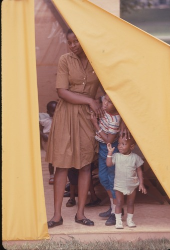 Image for Woman in brown dress with children - Resurrection City, Wash., D.C. - 1968