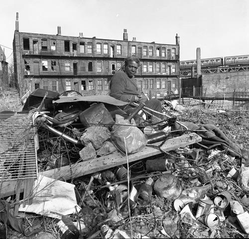 Image for Man sitting on debris pile - Roxbury, Mass. - 1969