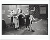 Image for Free Clothing Program, A Boy Tries on a Coat at a Party Office, Toledo, Ohio, 1971