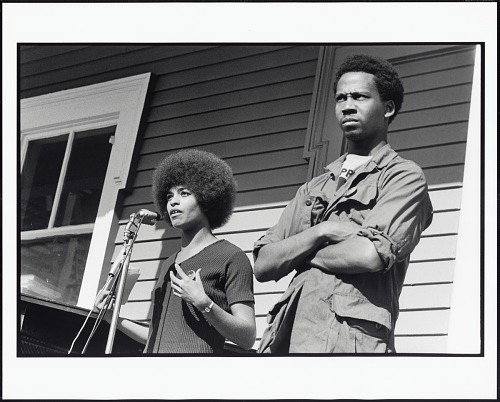 Image for Angela Davis Speaks at a Rally in DeFremery Park for George Jackson and the Other Soledad Brothers, Who Were on Trial for the Murder of a Guard at Soledad Prison. Next to Angela is Party Member James Burford, Oakland, California, 1970
