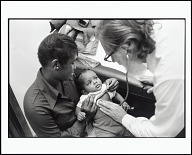 <I>Doctor Examines Baby at Health Clinic Run by the Black Panther Party, Chicago, Illinois, 1970</I>
