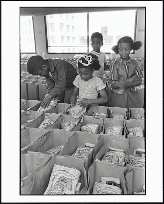 <I>Panther Free Food Program. Children Prepare Bags of Food for Distribution at the Oakland Coliseum at the Black Panther Community Survival Conference, Oakland, California, March 1972</I>