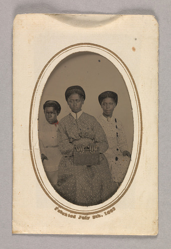 Image for Tintype in a paper case of three unidentified young women seated