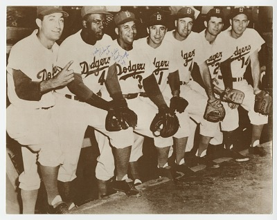 Photograph of Jackie Robinson and Roy Campanella with Brooklyn Dodger teammates