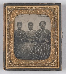 Ambrotype of three women in dotted calico dresses