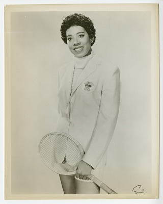 Photograph of Althea Gibson wearing the Wightman Cup jacket