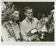 Photograph of Althea Gibson with the US Nationals trophy and Mal Anderson
