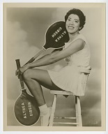 Photograph of Althea Gibson holding two tennis rackets