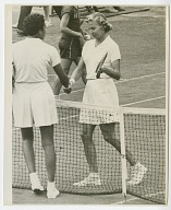 Photograph of Althea Gibson shaking hands with opponent Louise Brough