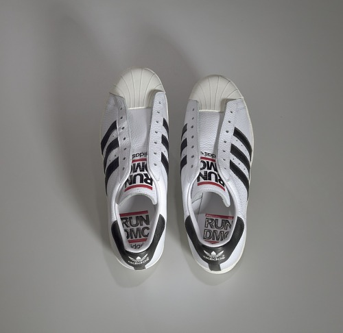 df9106b8a3cdba ... Image for Pair of white and black Run-D.M.C. Superstar 80s sneakers made  by Adidas