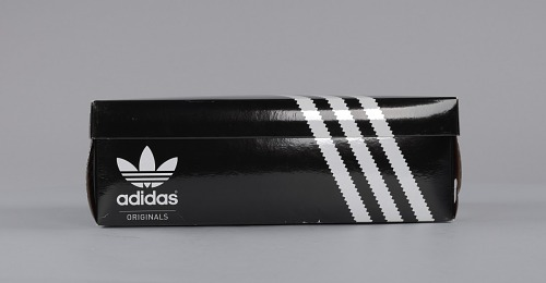 Image for Pair of white and black Run-D.M.C. Superstar 80s sneakers made by Adidas