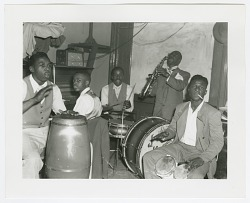 Photographic print of five jazz musicians
