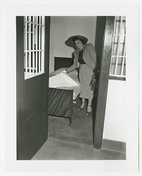 Photograph of Eunice Cook inspecting a jail cell at Centre Avenue police station