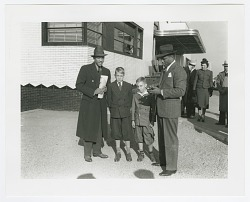 Photograph of Jesse Owens with a man and two boys at Allegheny County Airport