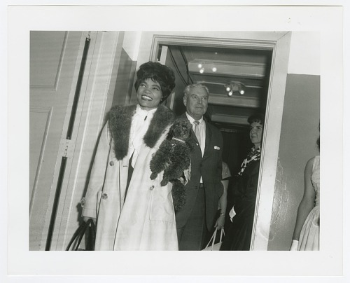 Image for Photographic print of Eartha Kitt carrying a poodle