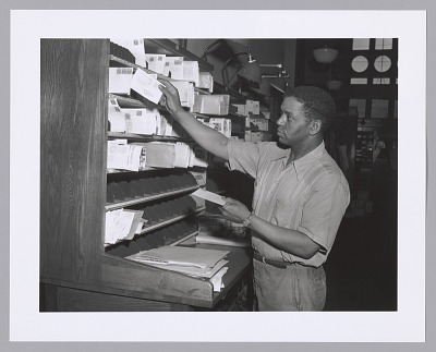 Photographic print of a postal worker