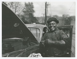 "Photographic print of auto mechanic Sam ""Scotty"" Scott"