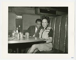 Photographic print of Louis Armstrong and Ann Baker in a booth at Crawford Grill