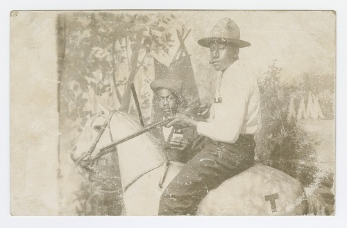Image for Postcard of two men posing in a Western scene in a photography studio
