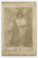 Photographic postcard portrait of Margarette Davenport in costume
