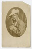 Thumbnail for Photographic postcard portrait of a man wearing a hat and overalls