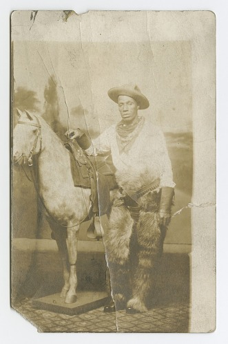 Image for Postcard of a man posing in a Western scene in a photography studio