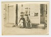 Thumbnail for Photograph of a man and woman sitting outside of a storefront