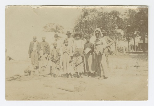 Image for Photograph of men, women, and children in a yard