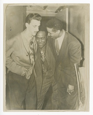 Photograph of Dizzy Gillespie, Charlie Parker and another man