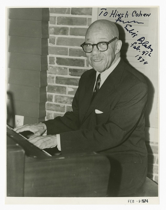 Image 1 for Autographed photograph of Eubie Blake playing the piano