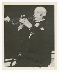 Photograph of an unidentified man playing a trumpet