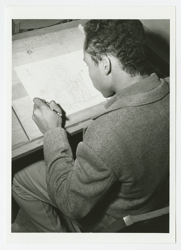Image for Photograph of a St. Augustine High School student drawing in art class