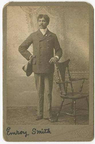 Image for Photograph of Emroy Smith standing next to a chair