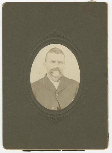 Image for Photograph of a man with a mustache wearing a dark jacket