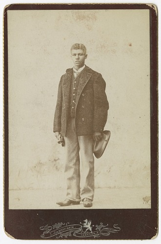 Image for Photograph of young man holding a hat and gloves