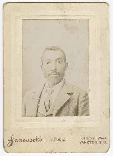 Image for Photograph of a man wearing a light colored jacket, vest and necktie