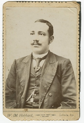 Image for Photograph of a man wearing a dark colored suit with a pocket watch in his vest