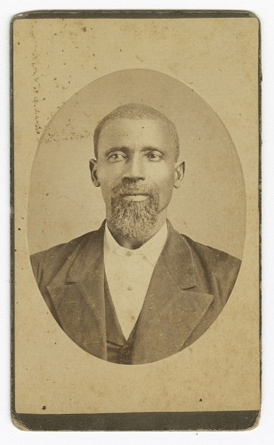 Image for Photograph of a man with a beard wearing a dark colored suit and vest