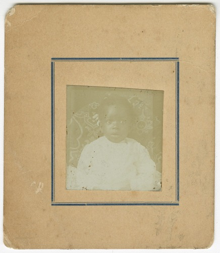 Image for Photograph of a baby sitting in a chair