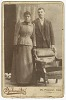Thumbnail for Photograph of a couple standing behind a chair